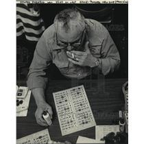 1983 Press Photo  Howard Pashrig pondered his Bingo game cards - mja06760
