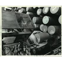 1982 Press Photo A worker stored paper rolls at Appleton Papers Inc. - mja18913