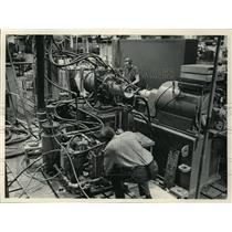 1983 Press Photo Man testing of a 2,400 volt induction motor - mja02825