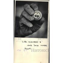 1983 Press Photo Carl Kucharski holds bingo number aloft  - mja06775
