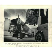 1986 Press Photo Michael D. Hamilton inspects products for export - mja09898