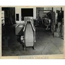 Press Photo Power Pack Conveyor - nef01724