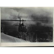 1974 Press Photo Helicopter Making a Mountain Rescue - orb27349