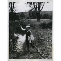 1934 Press Photo Boxer Jimmy McLarnin trains & fishes at Orangeburg NY