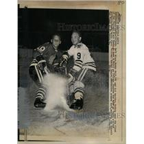 1965 Press Photo Bobby & Dennis Hull in action at Black Hawks vs Wings