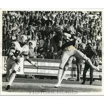 1976 Press Photo Raiders versus Patriots in football action - net14898