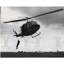 1971 Press Photo Man dropping off from the helicopter - spa22926