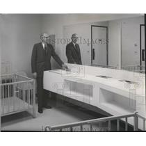 1965 Press Photo Manager Ballo Inspects Novel Nursery Room at Airport Terminal