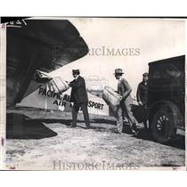 1950 Press Photo Postmaster John Jones helps load mail into open cockpit
