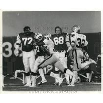 1976 Press Photo NY Jets James Slott tackled by Cedric Brown of the Raiders