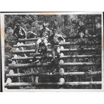 1969 Press Photo Boy Scout Scaling Logs on an Obstacle Course - spa28741