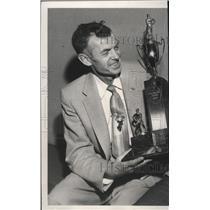 1957 Press Photo Sid Wheeler Presents Trophy to Spokane Flyer Goalie John Sofiak