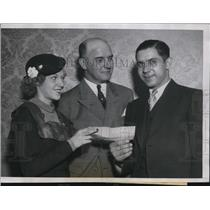 1934 Press Photo John Mincheski received check he won for Canadian Sweeptakes