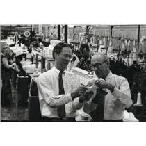 1983 Press Photo Robert Chesebro, and son check quality of sock at Wigwam Mills.