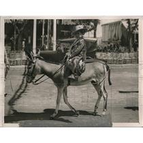 1927 Press Photo Boy Riding Mule in Seville Spain Easter Fair - ney14060