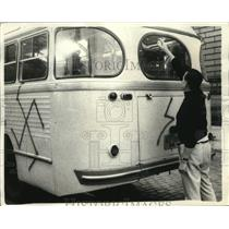 1968 Press Photo Russian Bus Being Painted with Swastika Graffiti in Berlin