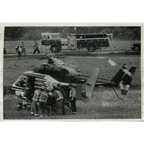 1991 Press Photo Rescue worker put injured John Bartolotta onto their helicopter
