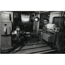 1989 Press Photo Sebastian Ebenhoch, product specialist inspects a drilling tool
