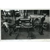 1989 Press Photo Workers saw lumber at Waukesha Industrial Lumber Inc.