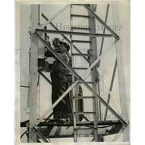 1940 Press Photo Westinghouse workers install switch on Forbes Field light tower