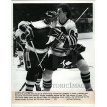 1982 Press Photo Black Hawk Doug Wilson vs North Star Brad Maxwell - net07040
