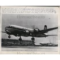 1953 Press Photo DC-7 Transport Plane Takes off in Santa Monica, California