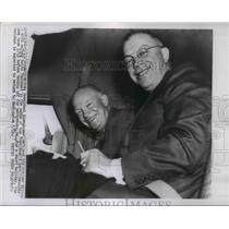 1956 Press Photo Eisenhower, Milton fasten safety belts in Aero Commander plane