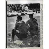 1962 Press Photo University students watch patrolmen across the street