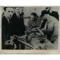 1939 Press Photo Wounded Civilian Comforted By Woman As He's Given ER Treatment