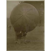 1923 Press Photo A man playing a game of push ball in a field - net20159