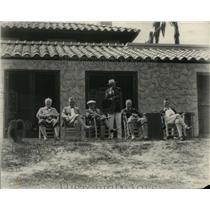 1927 Press Photo Men sit outside a lodge watching a sporting event - net21915