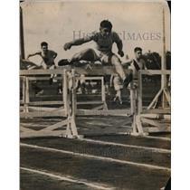 1919 Press Photo Robert Simpson in hurdles race at track meet - net22280