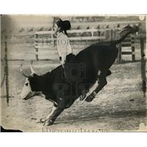 1925 Press Photo A cowboy on a bucking bull at a rodeo - net22768