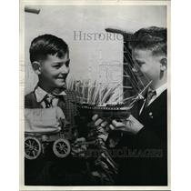 1936 Press Photo Boys Holding Transportation Covered Wagon & Ship Models