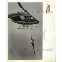 1991 Press Photo Helicopter lowering scissors for a shopping mall opening