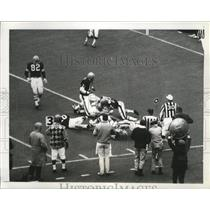 1970 Press Photo Bengals quarterback Virgil Carter tackled after run - nes52359