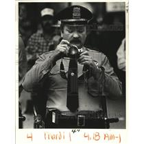 Press Photo New Orleans Mardi Gras policeman with camera - noca00889