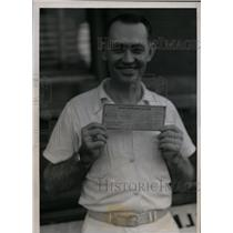 1939 Press Photo Claude Elkins hold the Lone winning ticket on the Daily Double