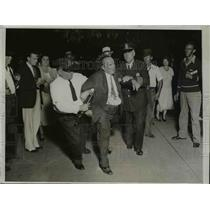 1932 Press Photo Urbain Ledoux led by police for White House Bonus Demonstration