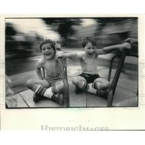 1984 Press Photo Joey and Nicholas Laehn on the merry-go-round at the state fair