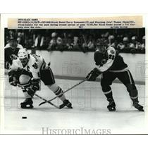 1951 Press Photo Black Hawk Terry Ruskowski vs Jets Thomas Steen - net26053