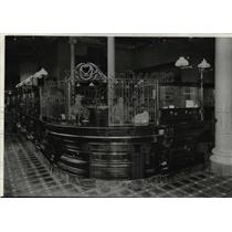 1894 Press Photo Bank teller's cages and gas lit lobby of First National in 1894