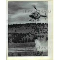1983 Press Photo BLM Helicopter with a Bucket of Filled Water - orb80276