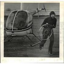 1986 Press Photo Curious George as he emerges from a helicopter at the Airport