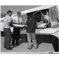 1963 Press Photo Mercy Flights Inc. Air Ambulance Left Transporting Patient