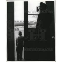 1961 Press Photo Boy Waiting at Airport on Delta Airlines Plane Atlanta, Georgia