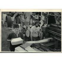 1983 Press Photo Marion Forga and Larry Hamilton Working at a Napkin converter