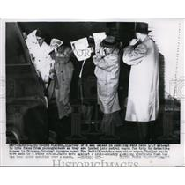 1956 Press Photo Four of 8 men seized in gambling raid attempt to hide faces