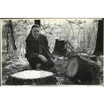 1982 Press Photo Yvonne Vavla checks the fir trees which were cut by thieves
