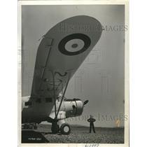 1941 Press Photo Member of Canada's Air Cadet League surveys a Lysander airplane